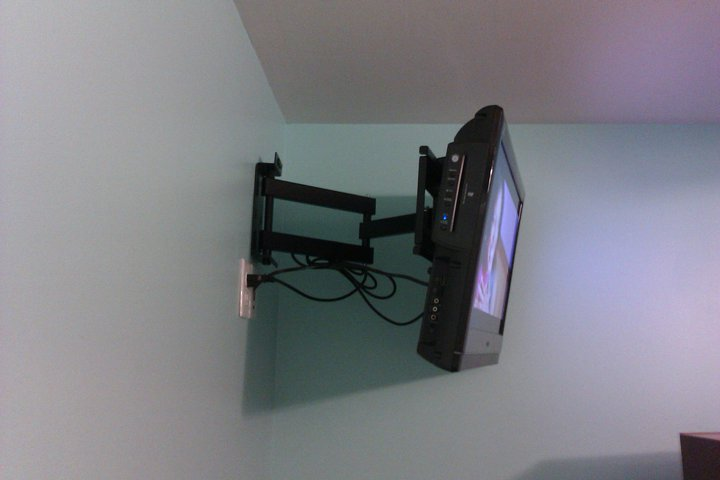 TV mounting full motion mount installation in corner with wires concealed