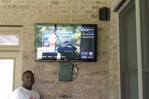 Exterior brick wall TV mounting